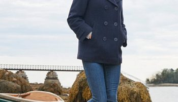 Woman wearing navy wool peacoat from LL Bean